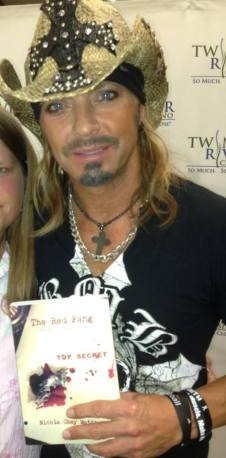 Bret Michaels with his autographed copy of THE RED FANG.